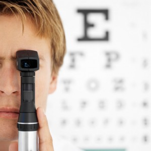 Young Male Optometrist Holding An Ophthalmoscope